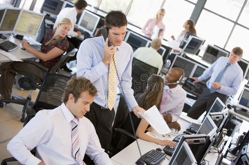 View Of Busy Stock Traders Office. With Traders Talking To Each Other And On The Phone royalty free stock images
