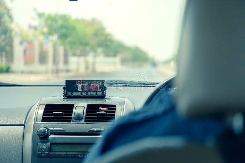 View from cab with meter display in Thailand. stock photos