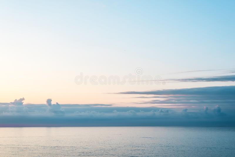 View from cabin balconies at the blue calm sea and sky with beautiful clouds off  side of cruise ship stock image
