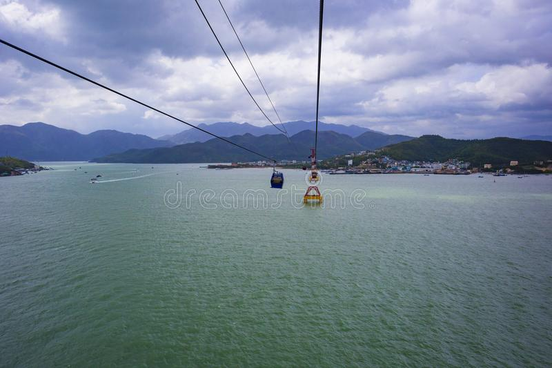 View from cabins of the world`s longest cable car cableway. With a beautiful view of the sea and mountains stock images