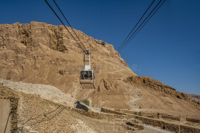 View of the cable car from a low point of view over Mount Massada Israel, the bottom construction, the ruins. stock photo