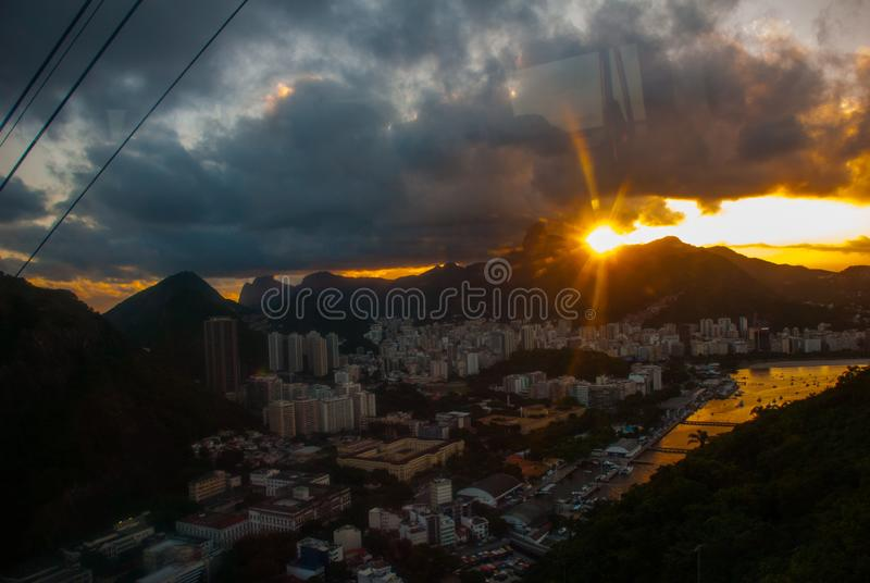 View of a cable car at sunset, showing several beaches and landmarks in Rio de Janeiro. Rio de Janeiro, Brazil royalty free stock images