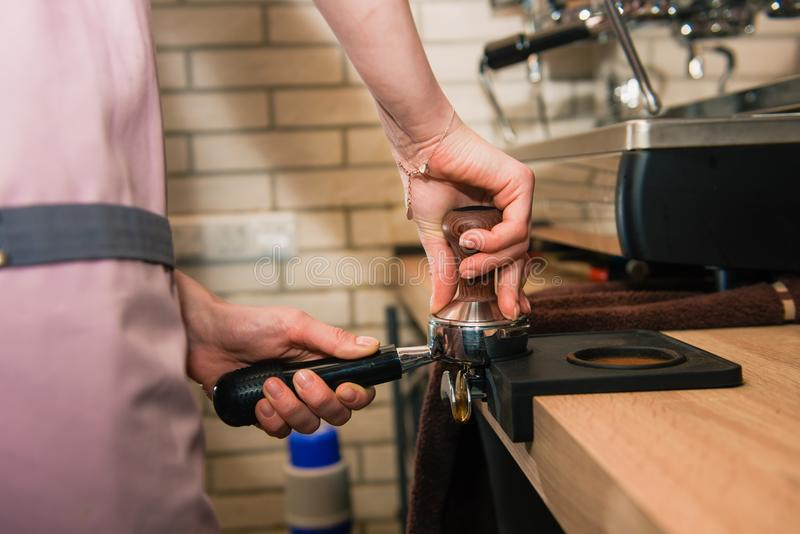 Barista with coffee machine holder royalty free stock images