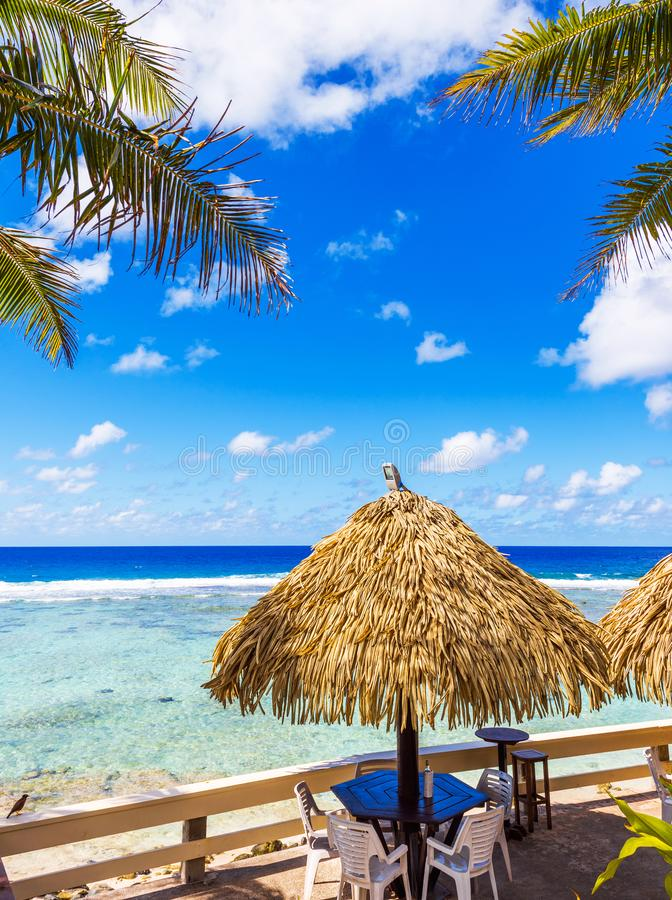View of the cafe by the ocean, Cook Islands, South Pacific. With selective focus. Vertical royalty free stock images
