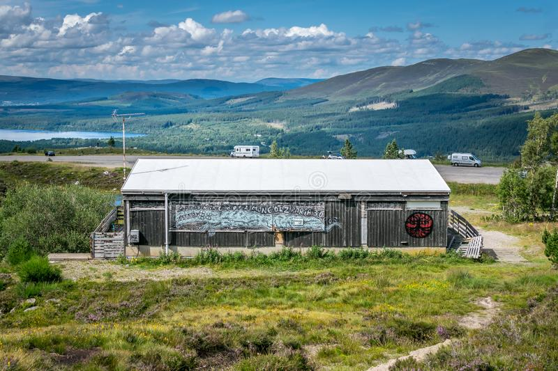 A view from Cairngorm mountains of an abandoned building and the valley below royalty free stock image
