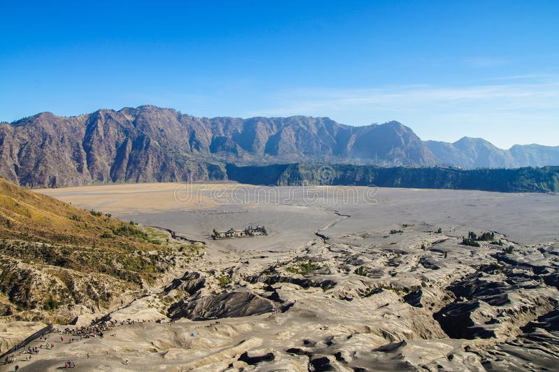 View on caldera of old volcano Tengger, Bromo Tengger Semeru Nat. View on caldera of old volcano Tengger snd Hindo temple, Bromo Tengger Semeru National Park royalty free stock photos