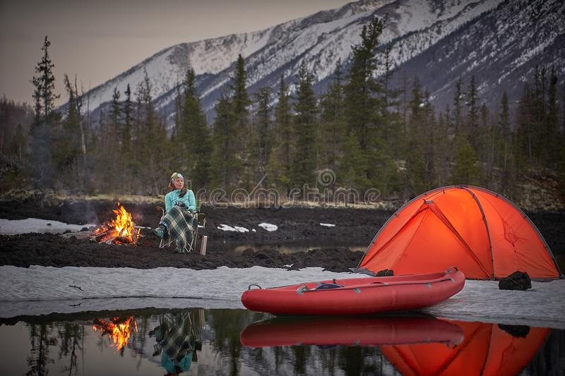 View of camp life in a mountain terrain. Lake shore with canoe royalty free stock photography