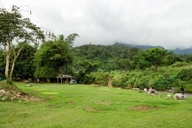 View on a campsite in rainforest near to river and mountains in cloudy weather. C. Hiang Dao, Thailand royalty free stock image