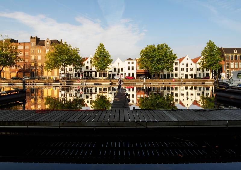 View of the canal with boats and beautiful buildings of Vlaardingen stock photo