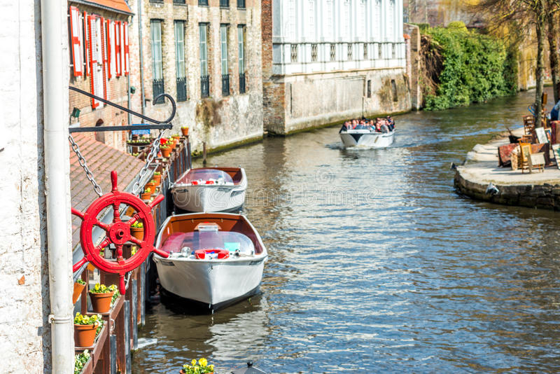 View on Canal in Brugge, Belgium. View on Canal and excursion boats in Brugge, Belgium stock image