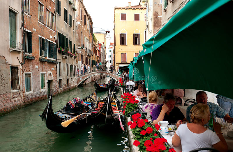 A view on a canal with gondolas in Venice. stock photo