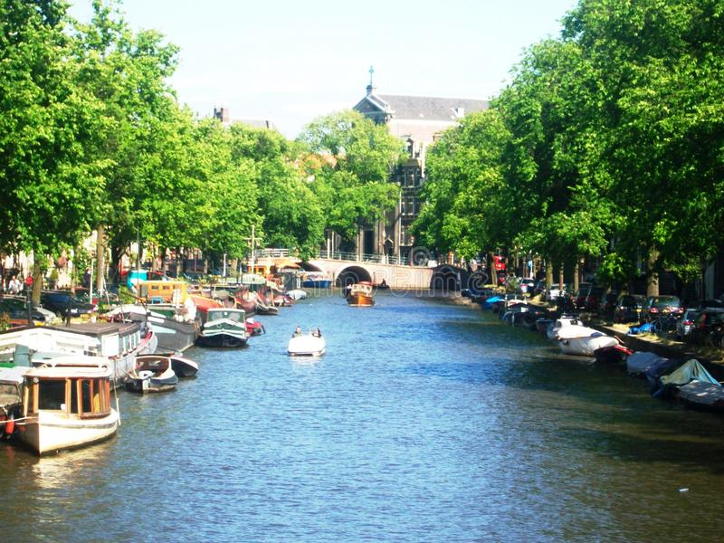 View of canal Prinsengracht in Amsterdam, Holland, the Netherlands. Sunny view of Prinsengracht canal in beautiful city Amsterdam, Holland. In the background you royalty free stock photos