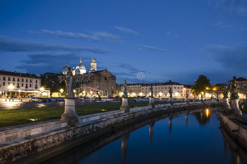 View of the canal with statues on square of Prato della Valle in Padova. After sunset, Italy, after rain royalty free stock photo