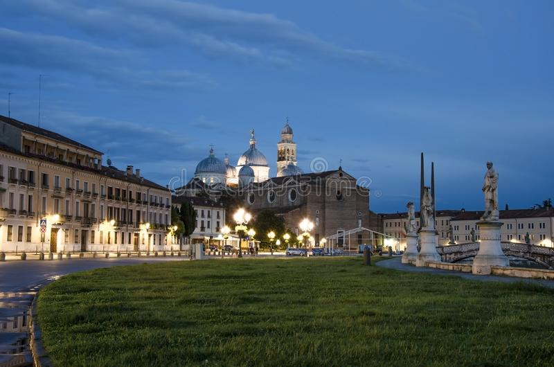 View of the canal with statues on square of Prato della Valle in Padova. After sunset, Italy, after rain stock photo
