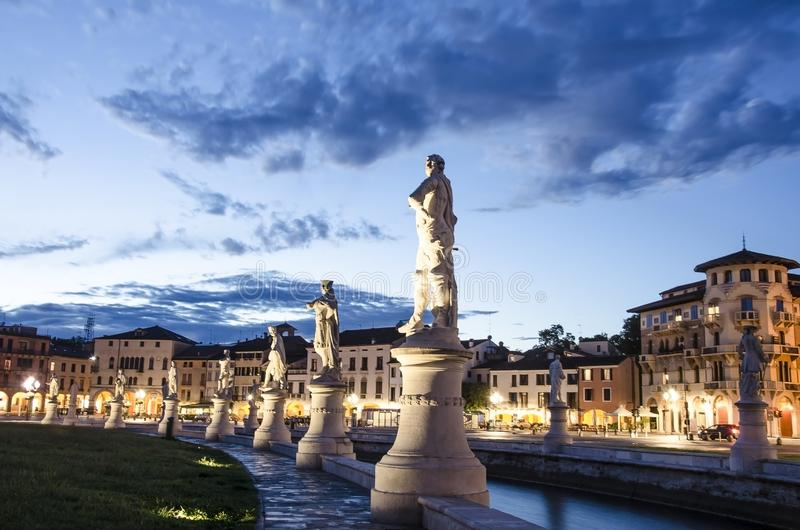 View of the canal with statues on square of Prato della Valle in Padova. After sunset, Italy, after rain stock image