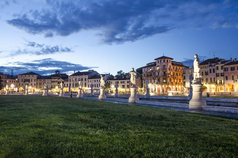 View of the canal with statues on square of Prato della Valle in Padova. After sunset, Italy, after rain royalty free stock photography