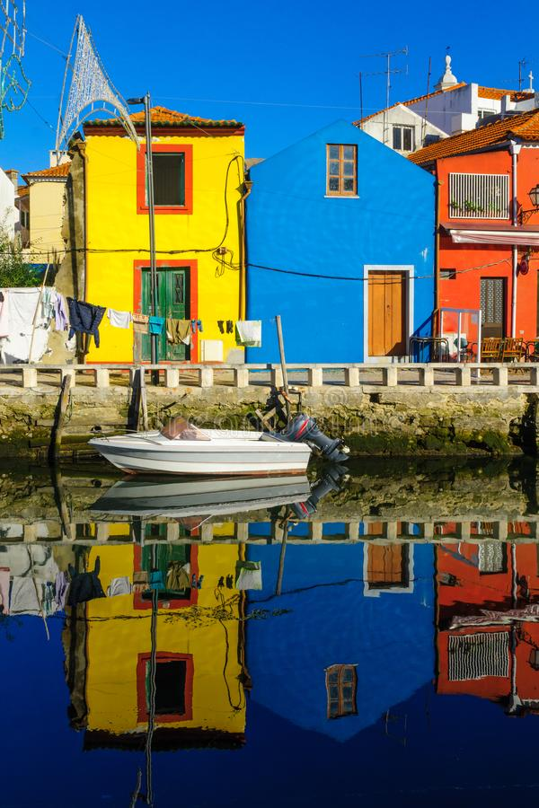Canals and boats in Aveiro. View of canals, boats, colorful houses, and laundry, in Aveiro, Portugal stock photos