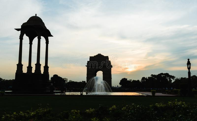 Canopy and India Gate at evening. View of canopy and India Gate, a war memorial astride of Rajpath from British India Army who died in first world war royalty free stock images