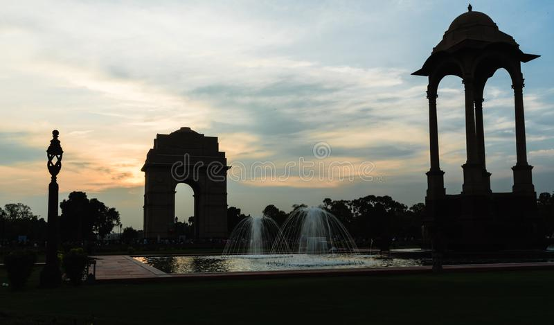Canopy and India Gate at evening. View of canopy and India Gate, a war memorial astride of Rajpath from British India Army who died in first world war royalty free stock photos