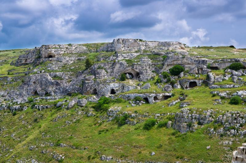 View of canyon with rocks and caves Murgia Timone, Matera Sassi, Italy. View of ravine canyon with rocks and houses in caves di Murgia Timone near old ancient royalty free stock photos