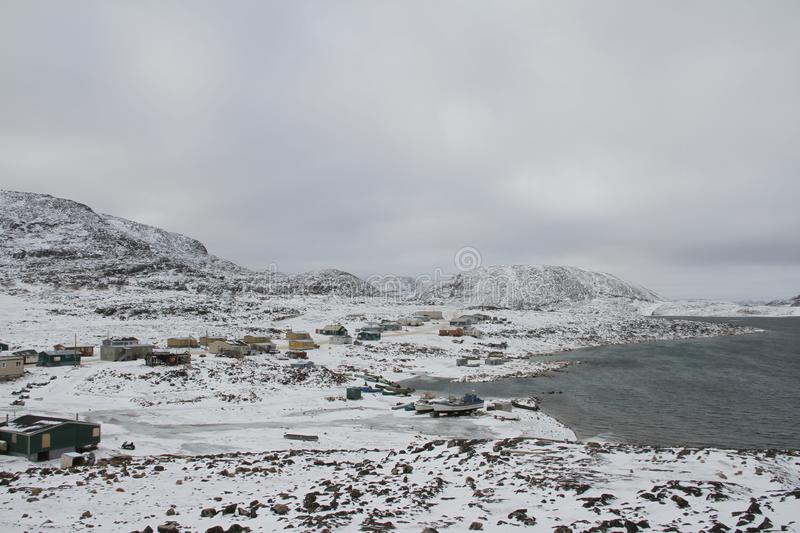 View of Cape Dorset Nunavut with a view of the mountains and ocean, a northern Inuit community. In arctic Canada stock photography