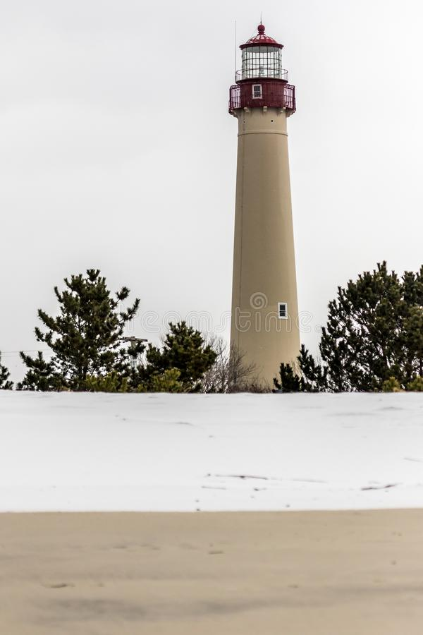 Cape May Lighthouse on a winter day with snow on the beach stock image