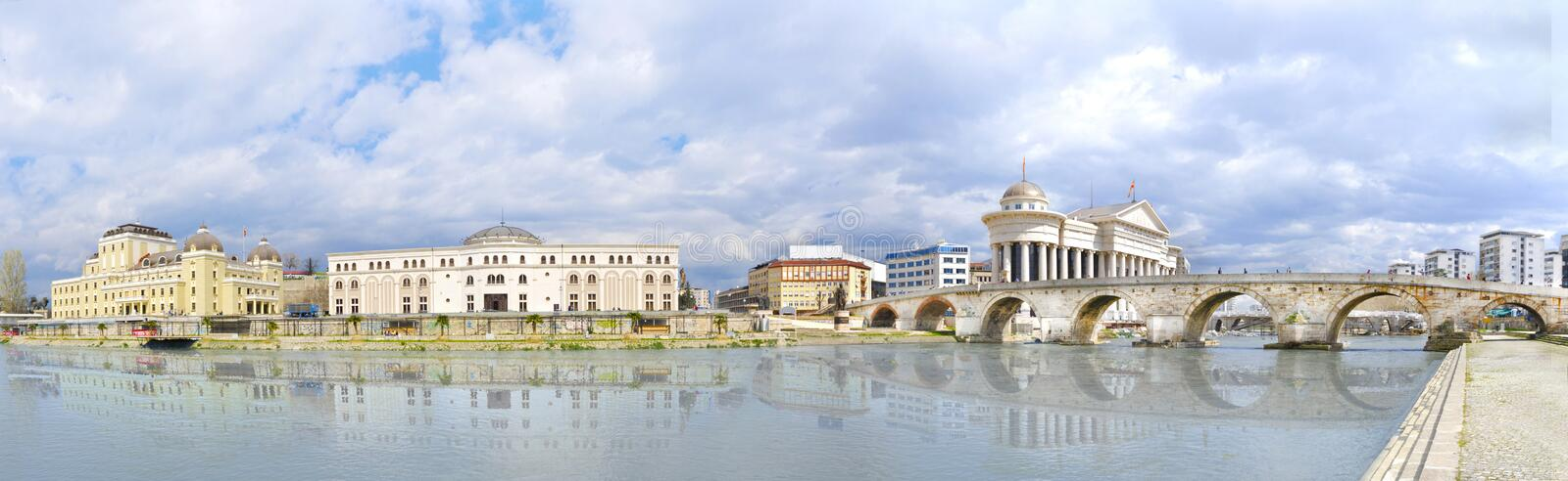 View of capital city of Macedonia - Skopje. Beautiful old stone bridge and archaeological museum of Macedonia, Vardar river wather reflection royalty free stock images