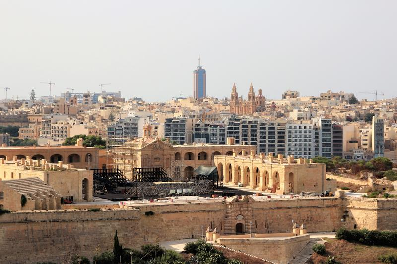 View of the capital of Malta from the sea, history and modernity. Medieval fortifications, gates in the wall, restoration of historic buildings, modern stock photo