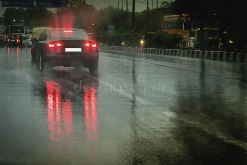 View from car on heavy rail. A view from car after heavy down pour. Car back light reflected on street royalty free stock images