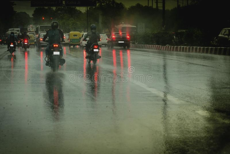 View from car on heavy rail. A scene from car after heavy rain. Traffic with light trails relected on street stock photos