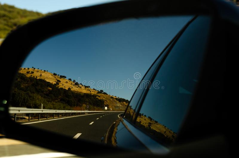 View in the car mirror on fast road in the Spain, beautiful land stock photos