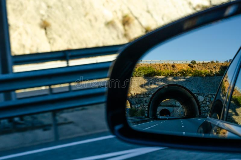 View in the car mirror on fast road in the Spain, beautiful landscape stock photos