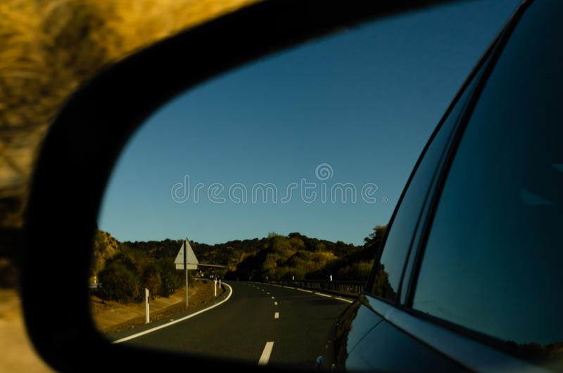 View in the car mirror on fast road in the Spain, beautiful landscape stock image