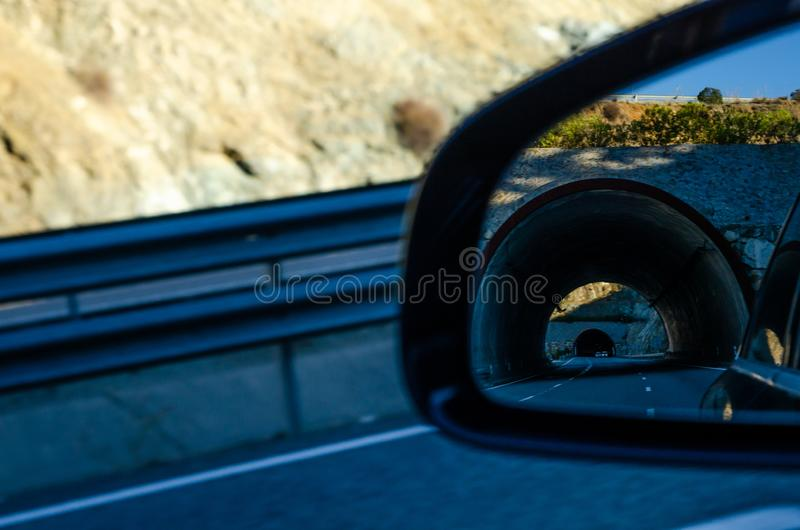 View in the car mirror on fast road in the Spain, beautiful landscape royalty free stock photography