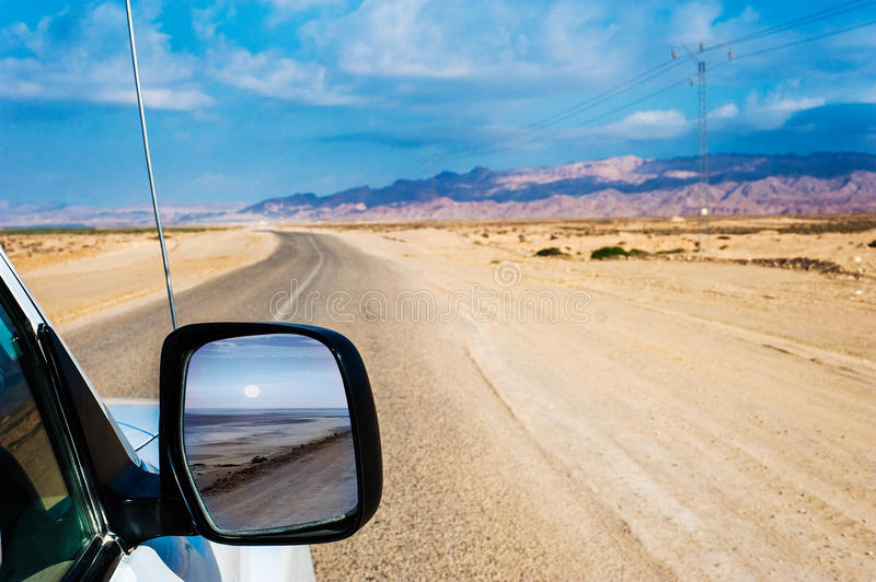 View through a car mirror. Landscape seen through a Car side mirror royalty free stock images