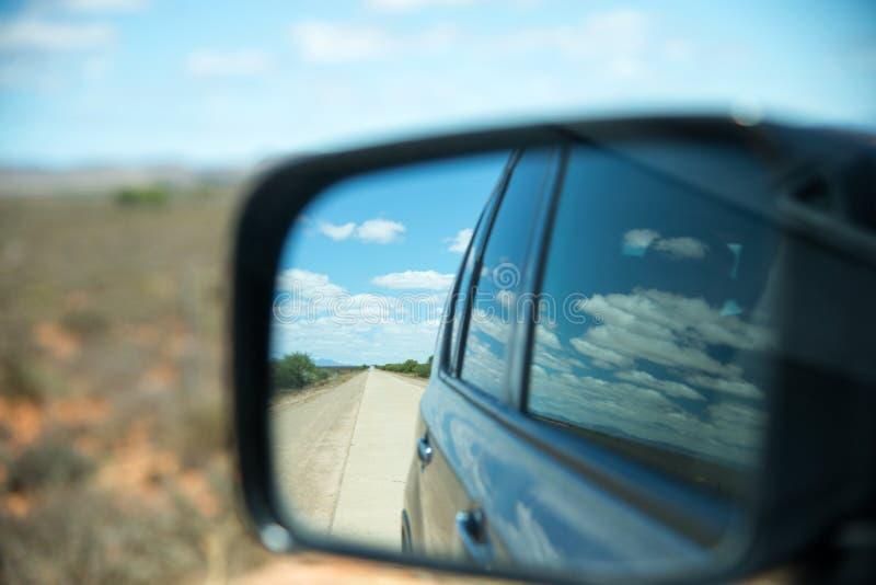 View through car mirror stock photography