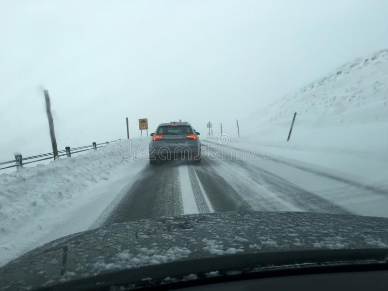 View from car window driving in heavy snow fall during winter travel from work to home. Uk stock photo