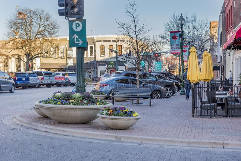 View of the cars parked by a paved street captured in McKinney, Texas, United States. MCKINNEY TEXAS, UNITED STATES - Dec 28, 2018: A view of the cars parked by royalty free stock photography