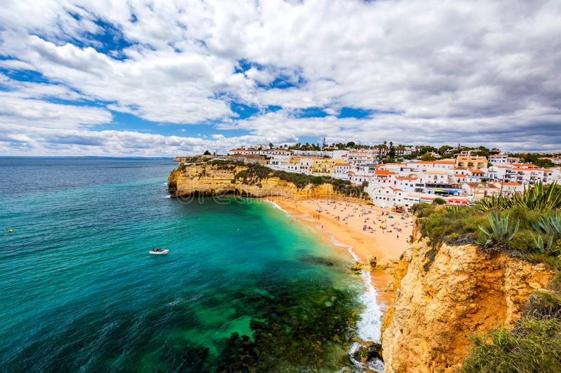 View of Carvoeiro fishing village with beautiful beach, Algarve, Portugal. View of beach in Carvoeiro town with colorful houses on stock photo