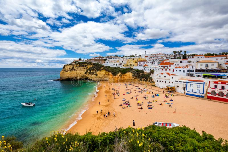 View of Carvoeiro fishing village with beautiful beach, Algarve, Portugal. View of beach in Carvoeiro town with colorful houses on stock images
