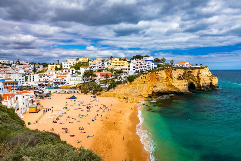 View of Carvoeiro fishing village with beautiful beach, Algarve, Portugal. View of beach in Carvoeiro town with colorful houses on royalty free stock photo