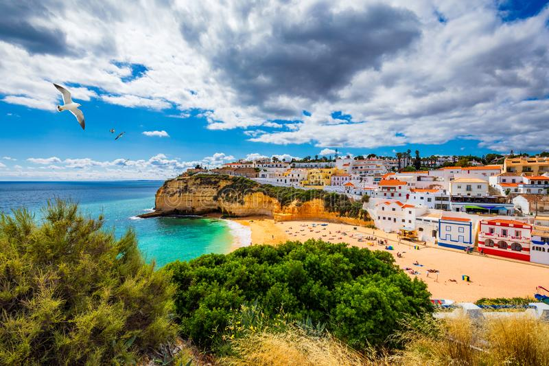 View of Carvoeiro fishing village with beautiful beach, Algarve, Portugal. View of beach in Carvoeiro town with colorful houses on stock photos