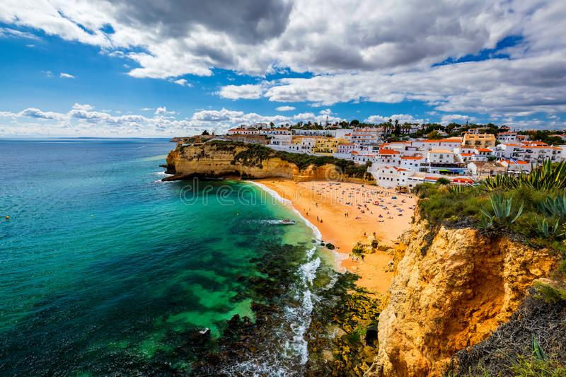 View of Carvoeiro fishing village with beautiful beach, Algarve, Portugal. View of beach in Carvoeiro town with colorful houses on stock photography