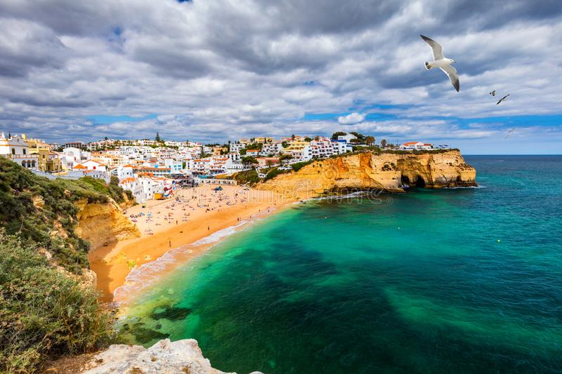 View of Carvoeiro fishing village with beautiful beach, Algarve, Portugal. View of beach in Carvoeiro town with colorful houses on. Coast of Portugal. The stock images