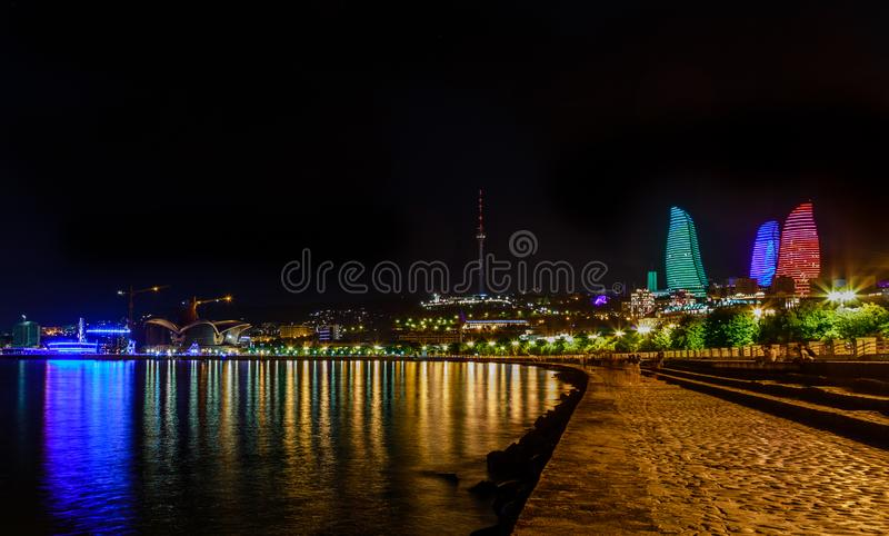 View from Caspian sea shore to the central business district with skyscrapers and tv tower, Baku royalty free stock photography