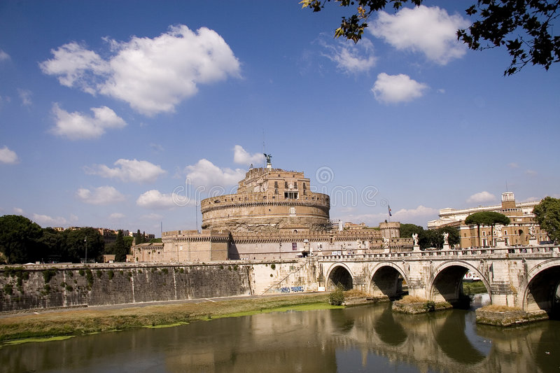 View of Castel Sant Angeleo. Scenic view of Castel Sant Angeleo, a ancient structure in Rome. Blue sky above the structure with calm waters below royalty free stock photo
