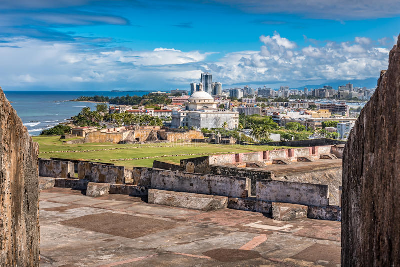 View from Castillo de San Cristobal toward town. With view of the Captial building in the foreground stock photography