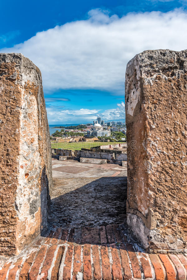View from Castillo de San Cristobal toward town. View from between stone pillers from top of Castillo de San Cristobal toward town royalty free stock images