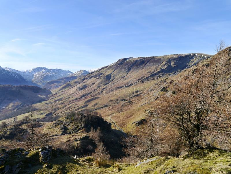 View from Castle Crag on a clear spring morning. Looking to High Scawdel way from Castle Crag, Borrowdale stock images