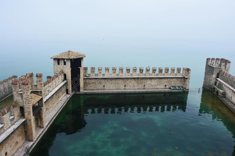 View from the castle of Lake Garda with fog, Sirmione, Italy.  royalty free stock images